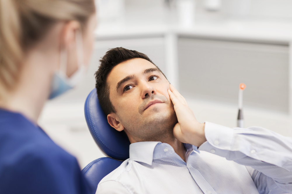 Surgical Tooth Extraction Dr. Fortinos at Orange California